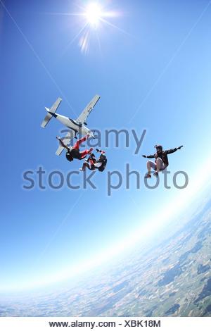 Skydivers free falling above Leutkirch, Bavaria, Germany - Stock Photo