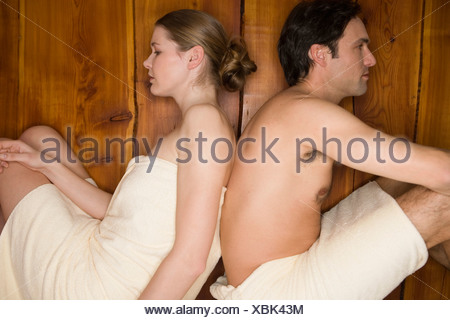 Couple in sauna room - Stock Photo