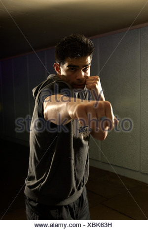 man throwing punch - Stock Photo