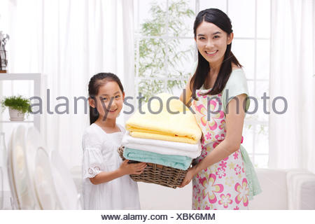 Mother and girl holding towels - Stock Photo