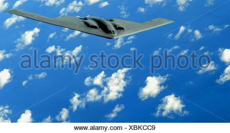 A B-2 Spirit deployed to Andersen Air Force Base, Guam, flies a training mission over the Pacific in support of the continuous - Stock Photo