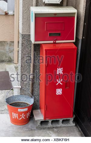 Kyoto, Japan, Traditional red fire bucket with water in front of the house as fire prevention in Kyoto.