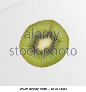 Slice Of Kiwi Fruit On White Background - Stock Photo
