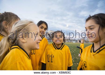 Soccer team on field at dusk - Stock Photo