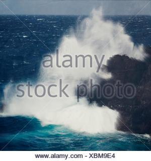 Spain, La Palma, Wind wave breaking at lava rock - Stock Photo