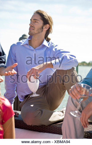 Man enjoying drinks with his friend at a party