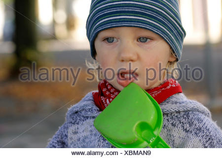 little boy with sandschovel - Stock Photo