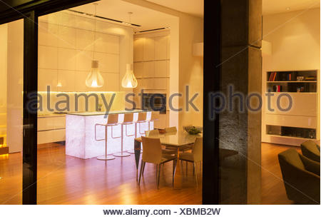 Kitchen and dining area in modern house - Stock Photo