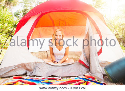 USA, Florida, Tequesta, Portrait of woman sitting in tent - Stock Photo