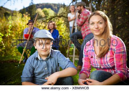 Multi-generation family in garden, Munich, Bavaria, Germany - Stock Photo