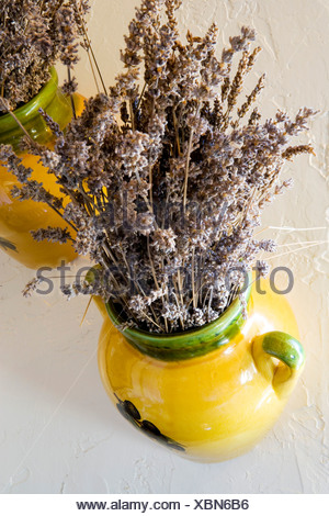 Dried Purple Flowers in Yellow Ceramic Jug - Stock Photo