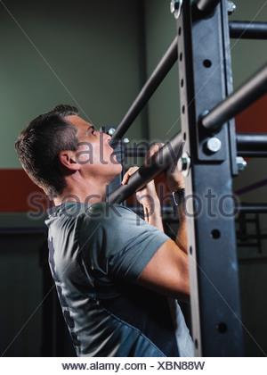 USA, California, Laguna Niguel, mature man pulling him up - Stock Photo