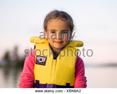 Girl in a personal floatation device - Stock Photo