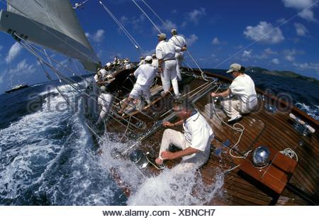Crew getting wet on 'Velsheda' at Antigua Classics, 1999. - Stock Photo