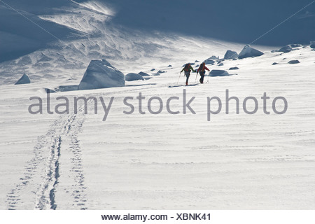 View of skiers breaking trail from, Tordrillo Mountains, Alaska - Stock Photo
