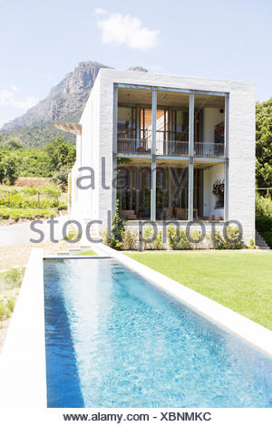 Modern house with swimming pool in rural landscape - Stock Photo