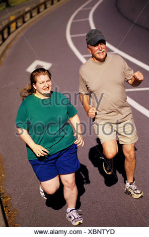 Overweight joggers - Stock Photo