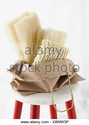 Dried noodles in paper bag - Stock Photo
