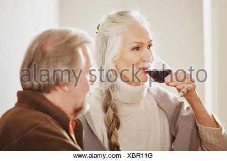 Senior woman drinking red wine - Stock Photo