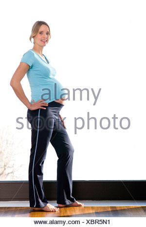 pregnant woman doing exercises - Stock Photo