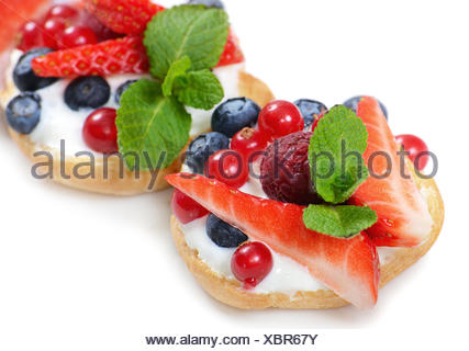 Profiteroles with berries currant , strawberries and blueberries - Stock Photo