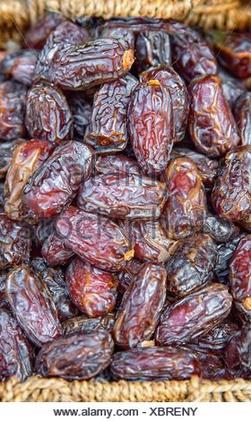 Dates in wicker basket at the market - Stock Photo