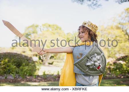 Profile view of boy dressing up in knight - Stock Photo