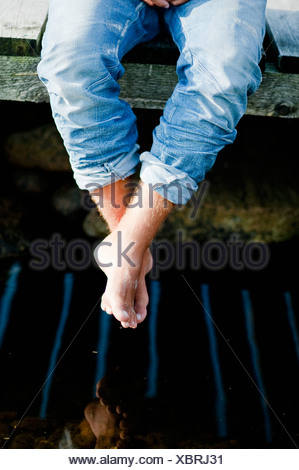 Sitting on the edge - Stock Photo