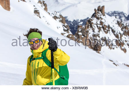 A Smiling Skier Giving Thumbs Up After Having A Fun Run On A Sunny Spring Day In The Backcountry Around Cerro Catedral In Argentina - Stock Photo