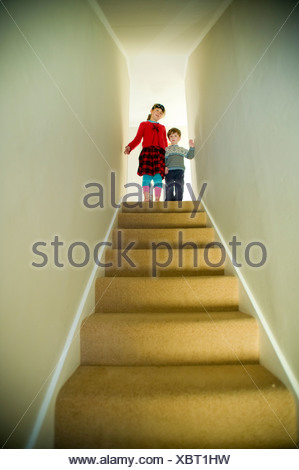 Low angle view of a boy and a girl on the top of the staircase, Ithaca, New York State, USA - Stock Photo