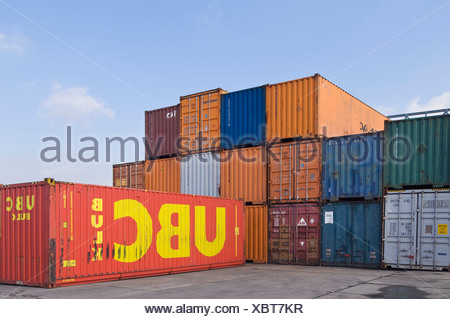 Stacked oversea containers in a depot, container terminal in Bonn, North Rhine-Westphalia, Germany, Europe - Stock Photo