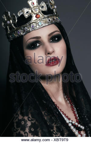 Face of Witch in Silver Crown with Jewels - Stock Photo