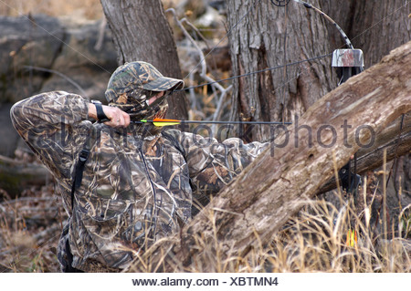 A bow hunter completely cover in Two bow hunter covered in Two bow hunter covered in A bow hunter, covered in Two bow hunter cov - Stock Photo