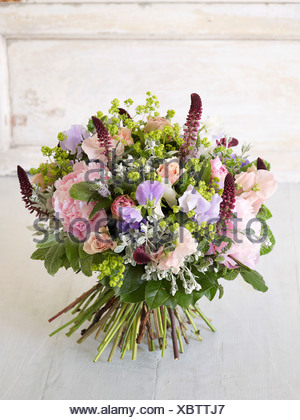 Bouquet of flowers including alchemilla, rose, peony, iysimachia, sweetpea - Stock Photo