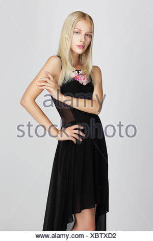 Sophisticated Lady in Black Silky Evening Dress Gracefully Posing - Stock Photo