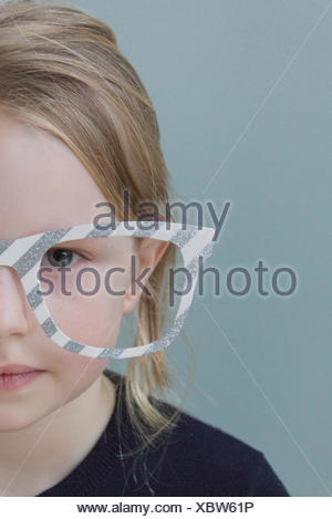 Portrait of a girl wearing oversized glasses - Stock Photo