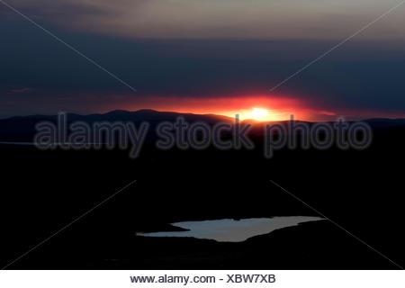Sunset behind the ash and gas cloud of the Holuhraun fissure eruption, near the volcano Bárðarbunga, highlands - Stock Photo