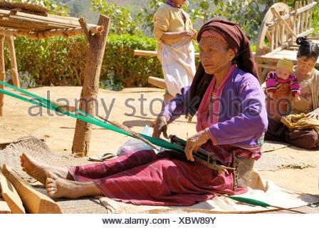 Senior tribal woman weaving Kalaw Shan State Myanmar - Stock Photo