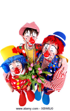 mother with sons dressed up as clowns - Stock Photo