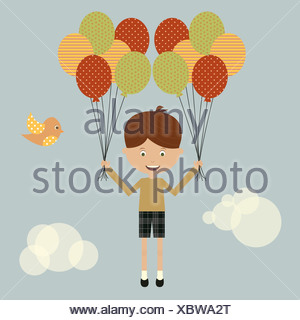A boy floating away with balloons - Stock Photo