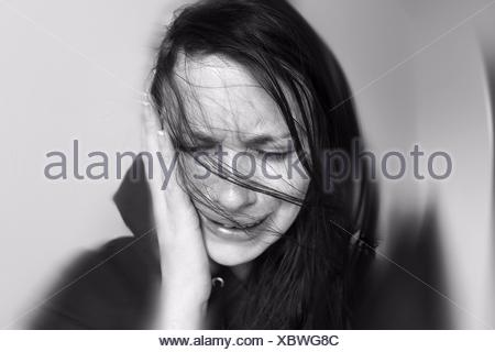 Close-Up Sad Woman Against White Background