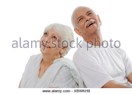 Old couple smiling - Stock Photo
