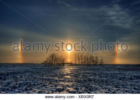 Sundogs on the Canadian prairie Lorette Manitoba Canada - Stock Photo