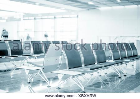 Empty seats in an airport waiting lounge. - Stock Photo