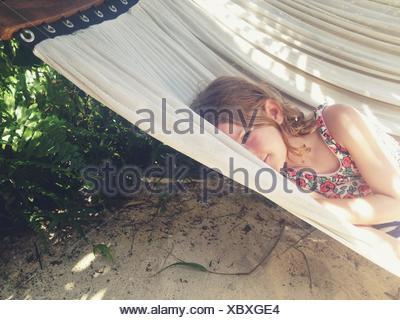 Girl lying in a hammock - Stock Photo