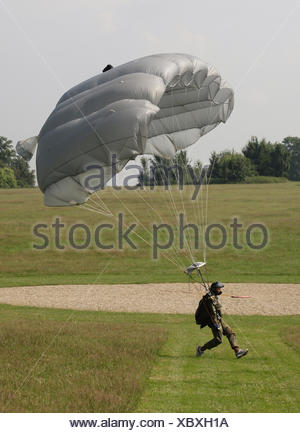 Paratrooper landing with a paraglider beside the target, 13th International Paratrooper Competition of the Special Operations - Stock Photo