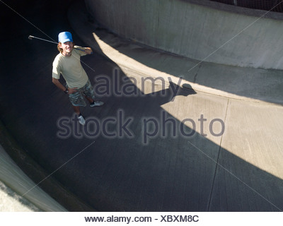 Young male urban golfer - Stock Photo