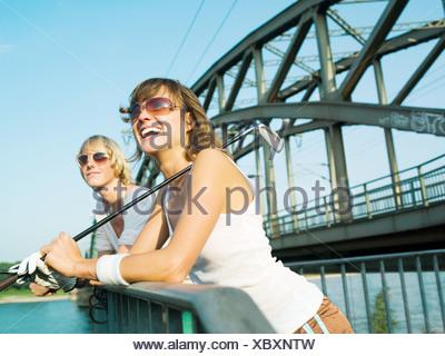 Female golfers by a bridge - Stock Photo