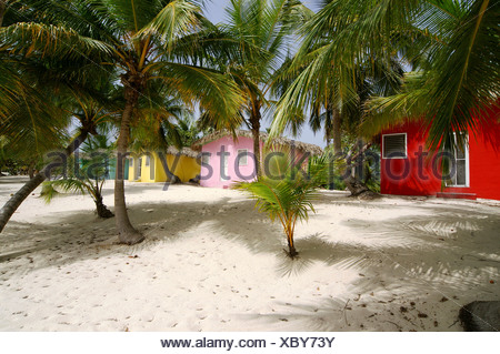 Colourful Caribbean guesthouses on the beach, Catalina Island, Dominican Republic, Caribbean, Americas - Stock Photo