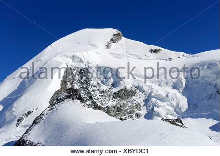 Mt. Allalinhorn, Pennine Alps near Saas Fee, Valais, Switzerland, Europe - Stock Photo